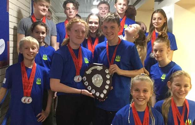 Members of Lichfield Swimming Club celebrate their success at the City of Stoke meet