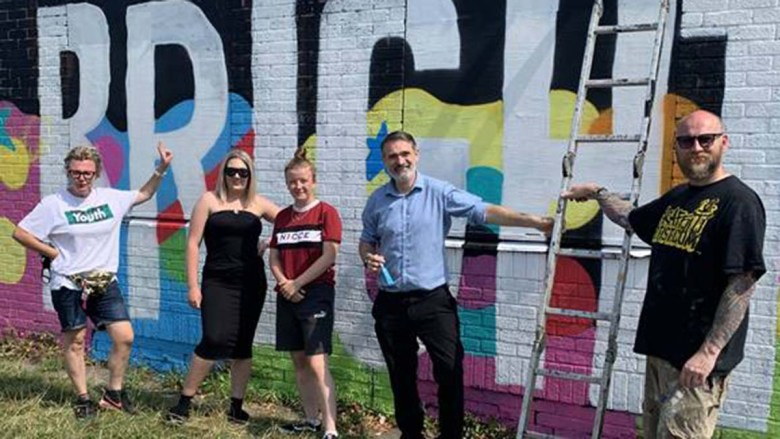 Cllr Darren Ennis with some of those who helped to create the mural