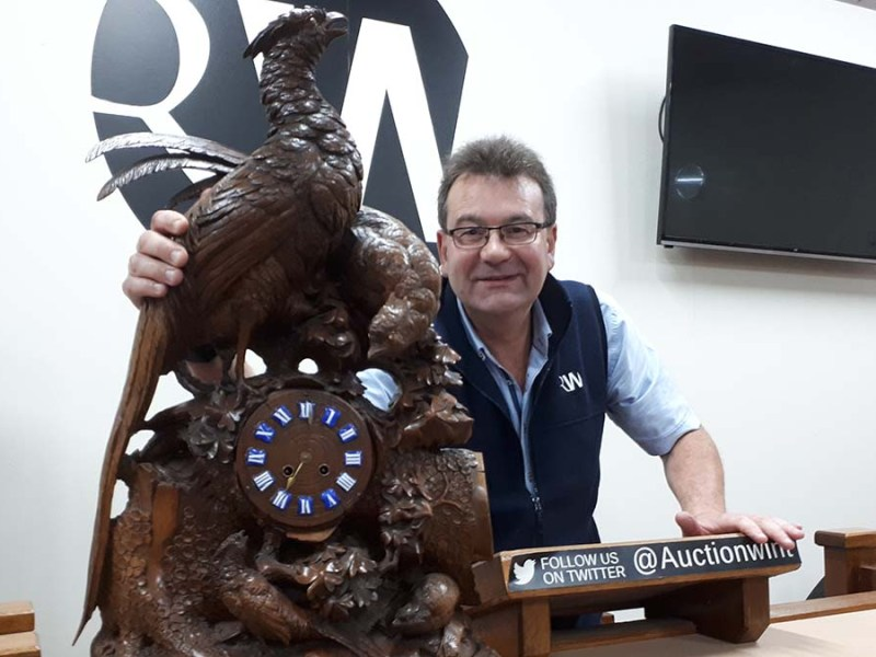 Richard Winterton with one of the clocks