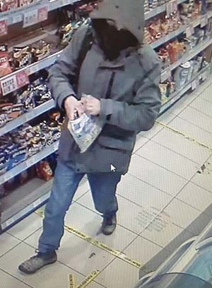 CCTV of the man wanted in connection with the petrol station robbery in Lichfield