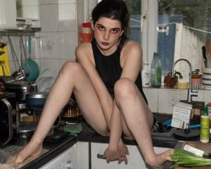 Woman sitting on the kitchen