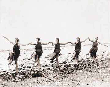 women dancing on the beach