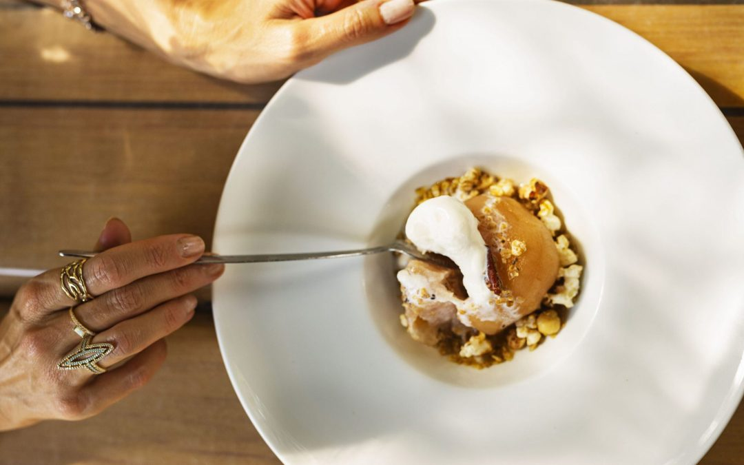 Maple Poached Apple with Popcorn Granola and Vanilla Ice Cream