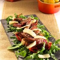 Eén keer koken, twee keer eten: Tagliata met parmezaan en rucola