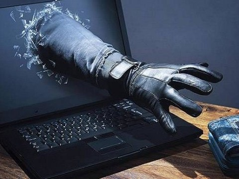 Cyber-Criminal committing Cyber-Crime, Hackers marketplace. - wherecyber-criminals are making lucrative salarys by Hacking American Citizens, Enterprises and the US Government .