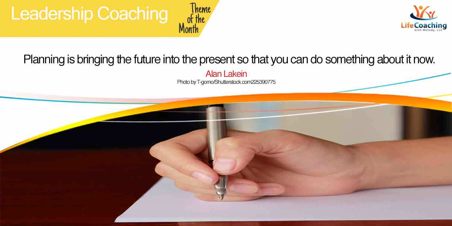 Hand with pen writing on paper. Quote Planning is bringing the future into the present so that you can do something about it now.