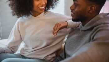 happy black couple communicating in room