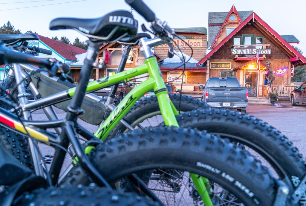 Fat bikes with the Sawmill Saloon in the background