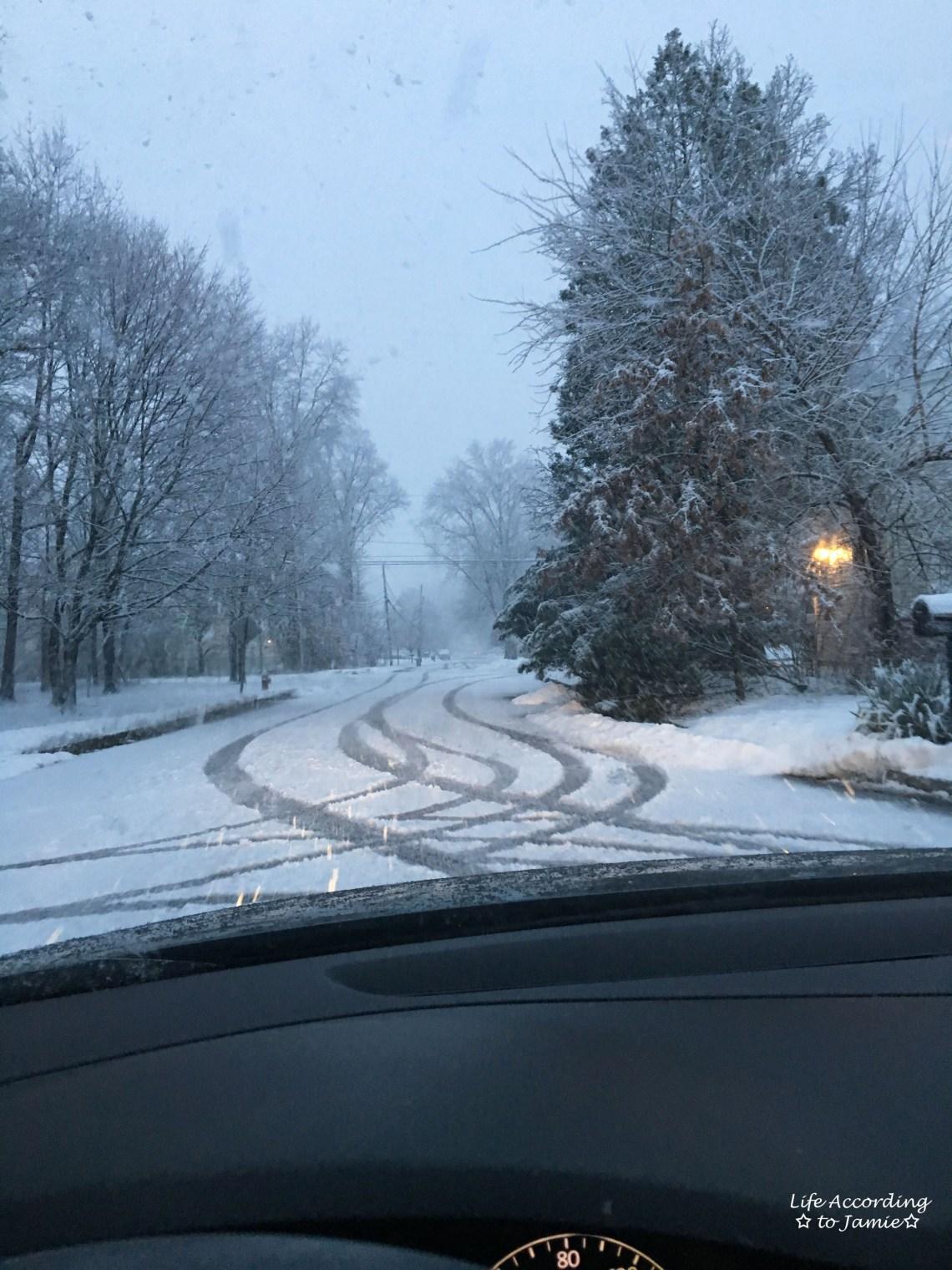 tire-tracks-on-snowy-road