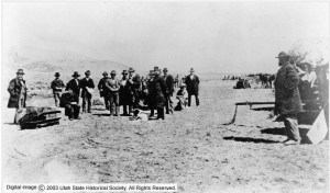 John D Lee sitting on his coffin before execution
