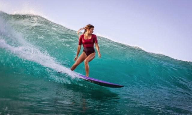 women surfing