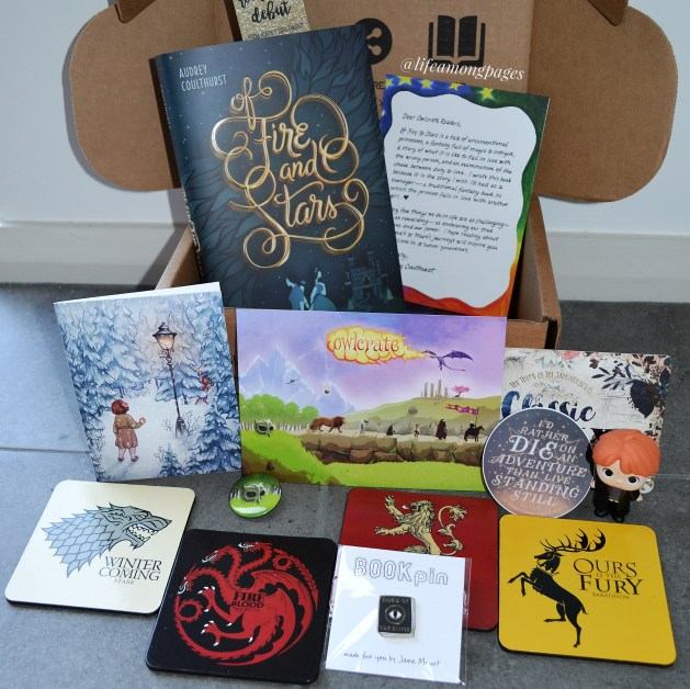 The full unboxing of the Owlcrate December Epic box, including the book 'Of Fire and Stars' and all the bookish items.