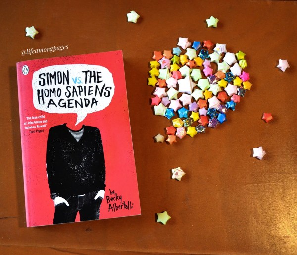 Simon vs the Homo Sapiens Agenda book surrounded by paper stars