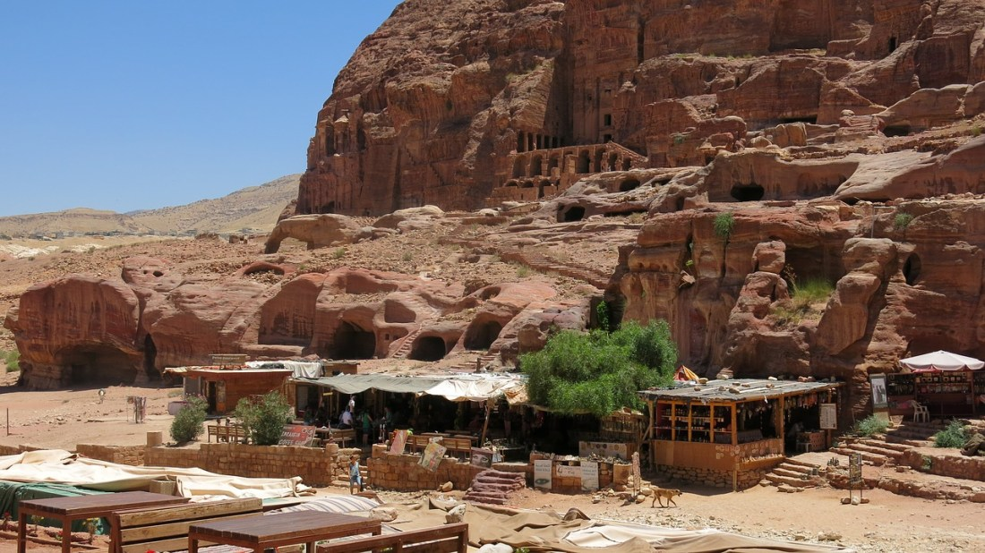Take a moment's rest and visit one of the many souvenir shops ran by Bedouins in Petra just before you go down the Colonnaded Street. Visiting Petra, the ancient Rose City, and a UNESCO World Heritage site should be on every Jordan travel itinerary and here's a guide to help
