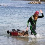 Sean Conway completes longest triathlon in history today at Lulworth Cove, Dorset. Credit - Discovery Communications.