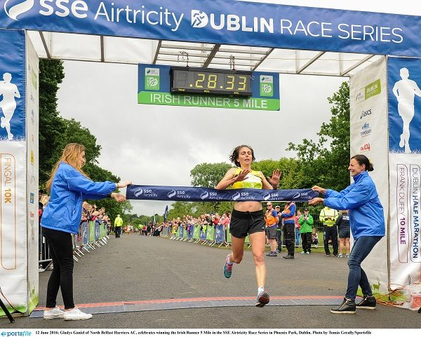 12 June 2016; Gladys Ganiel of North Belfast Harriers AC, celebrates winning the Irish Runner 5 Mile in the SSE Airtricity Race Series in Phoenix Park, Dublin. Photo by Tomás Greally/Sportsfile