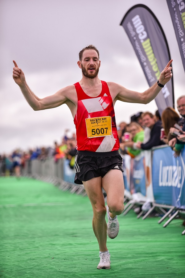 Kevin English the winner of Run Galway Bay Marathon pictured crossing the finish line with the time of 2:48:54.