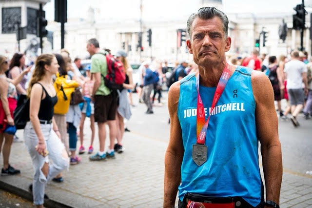 Judge Craig Mitchell, the star of the inspirational documentary Skid Row Marathon, completes his 74th marathon in London at the age of 62