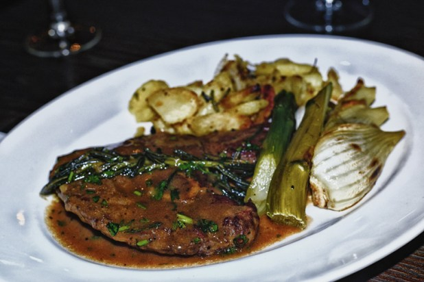 Pan fried lamb steak with white wine & rosemary sauce served with fennel & potatoes.