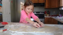 Fi was so helpful this year, she could roll, cut, and put the cookies on the tray.
