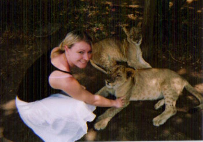 baby lion cuddle