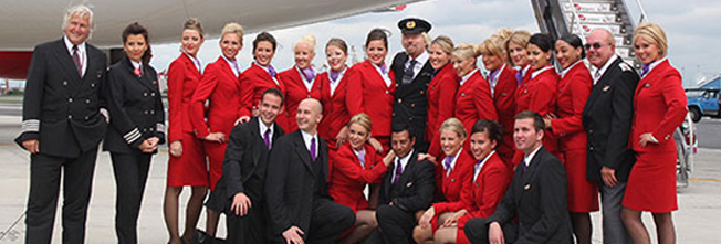Richard Branson and cabin crew on our 25th anniversary
