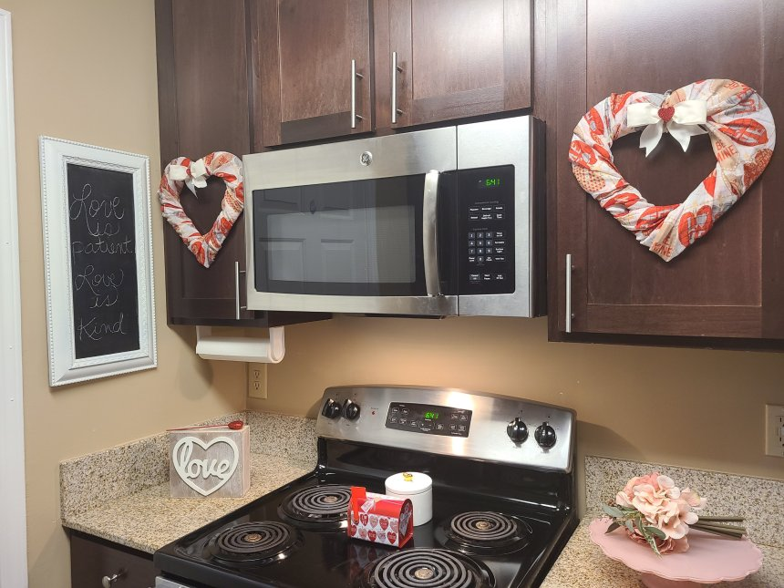 DIY Valentine's wreaths hung on cabinet doors.
