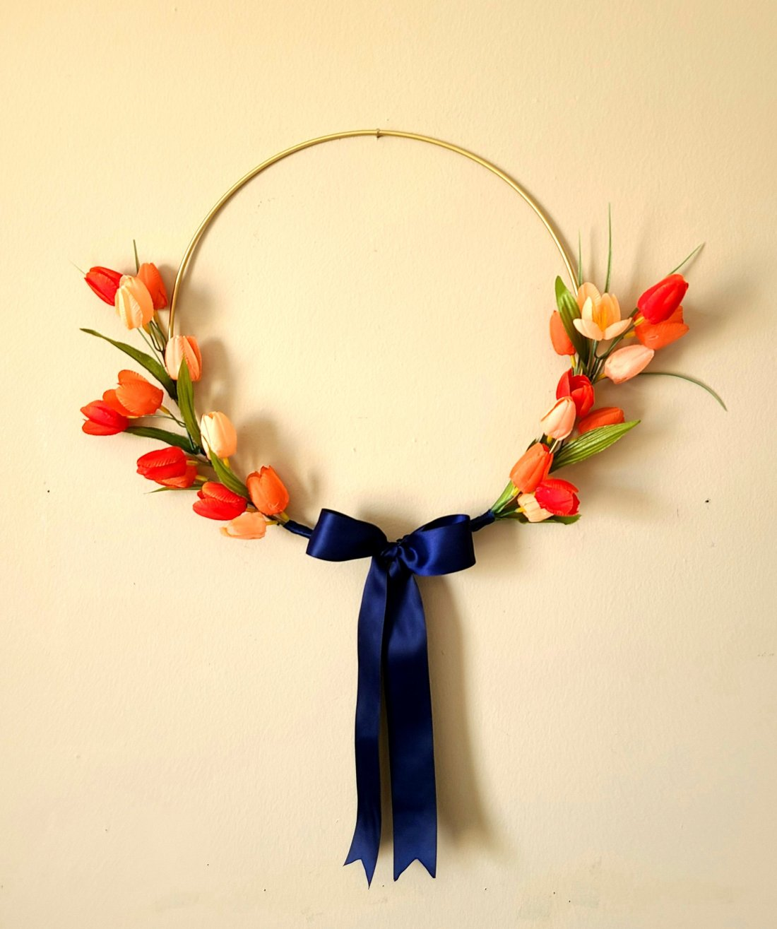 spring hoop wreath gold with a navy bow and melon and yellow tulips