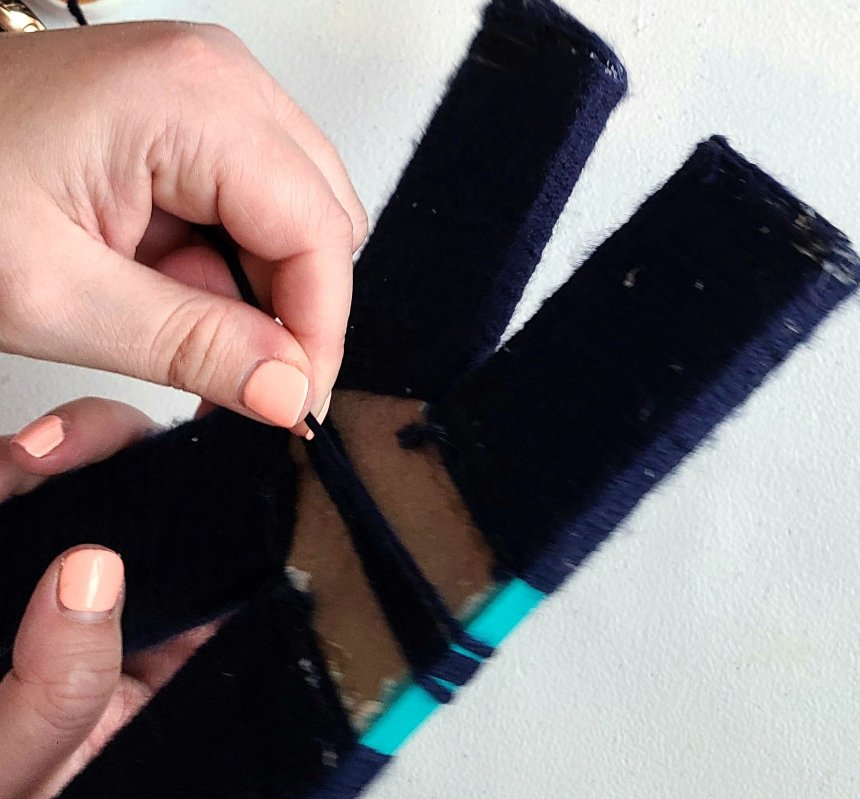 navy yarn wrapped around nautical initial K.