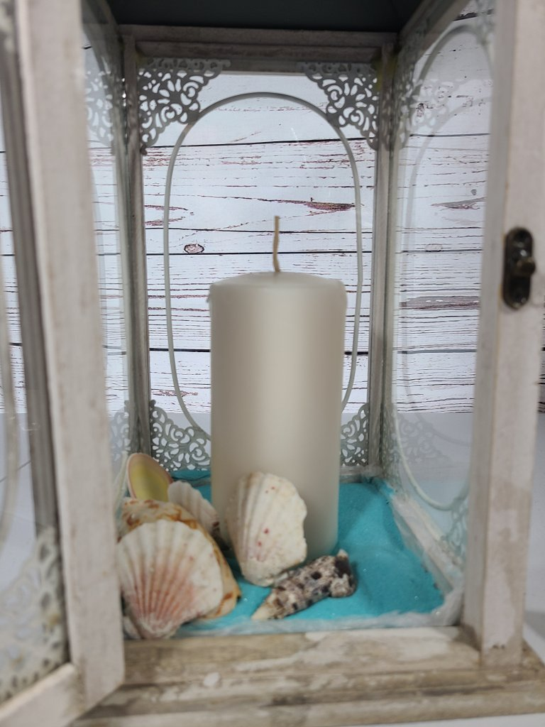 Adding the first layer of shells in the summer lantern.