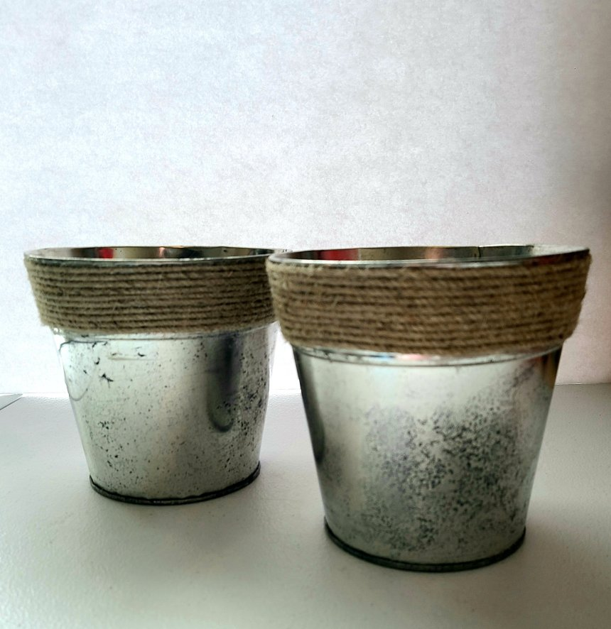 Complete DIY aged metal galvanized farmhouse flower pot. Two pots with twine trim around the top edge.