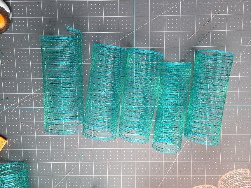 Spiral deco mesh rolls in teal.