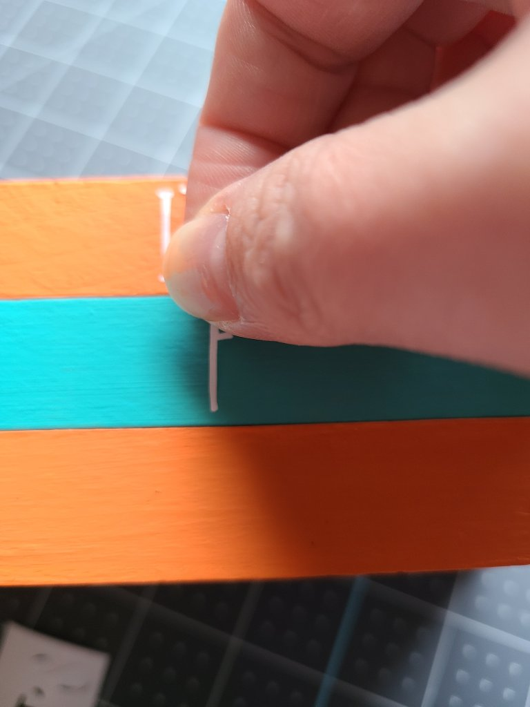 Adding stickers to the spines of the faux reversible books.