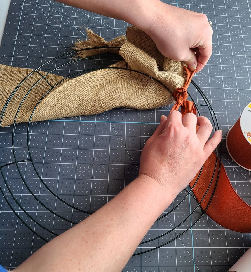 Tie the accent ribbon to the innermost ring on the burlap wreath.