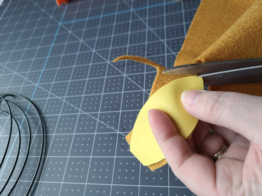 Mustard felt leaf almost completely cut out. It will be added to the felt leaf wreath.