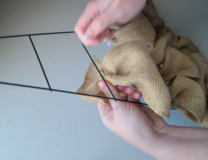 Burlap witch hat wreath: burlap being attached to the 3rd wire down from the top of the point.
