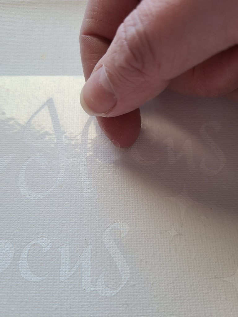 """Placing the center of an o in the word """"hocus"""" in my stencil on canvas."""