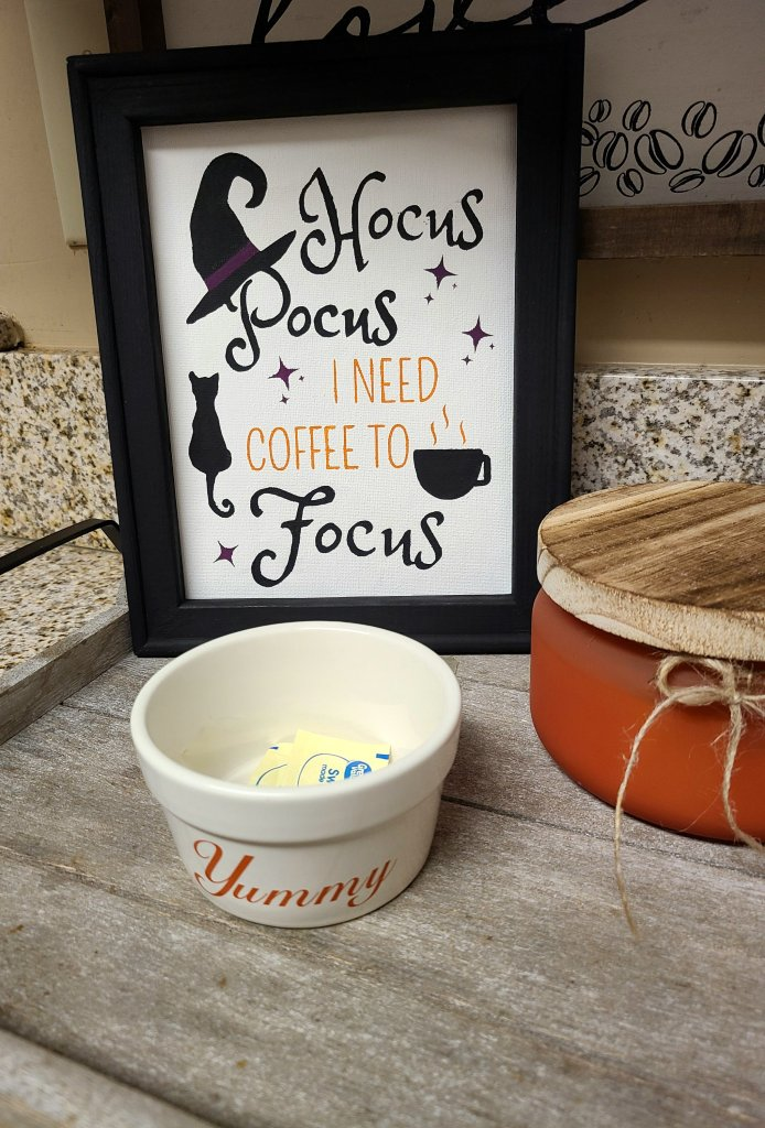 """Hocus Pocus sign with """"Yummy"""" bowl for Splenda packets in front."""