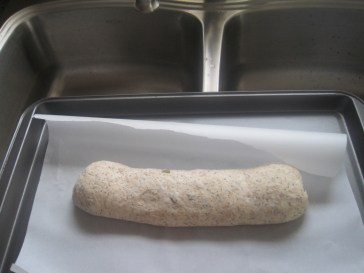 this loaf was proved covered with a long/deep lid of a pot; no shaper/basket was used