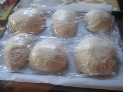 small loaves covered in stretch film prior to proofing