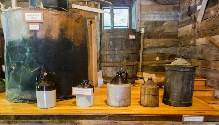 oil cans, moonshine, distiller, old, antique, learning, travel, adventure, family, history