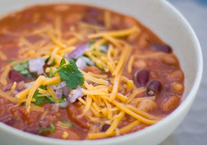 Crock Pot Vegetarain Chili original photo from 2010 with chili in a bowl topped with cheese and cilantro