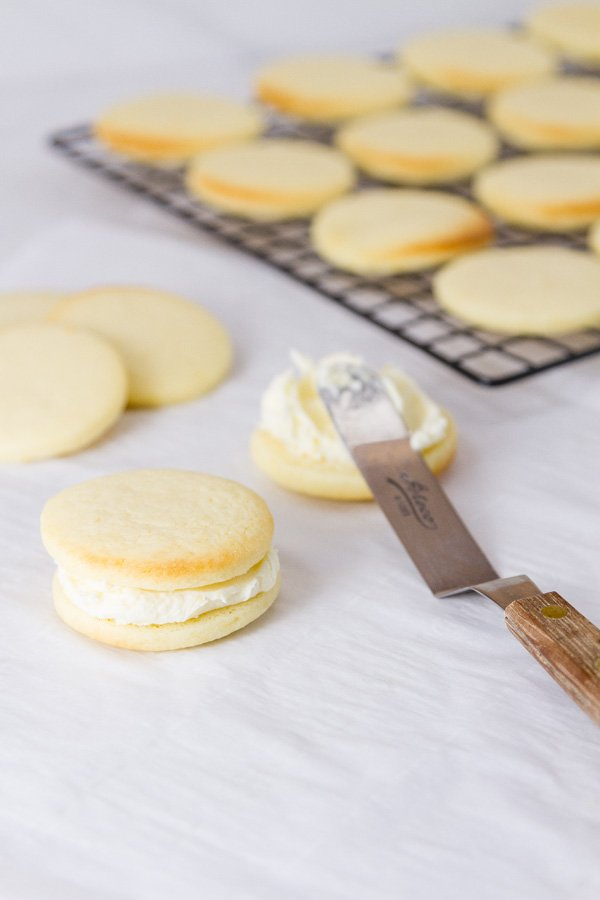 frosting the sandwich cookies