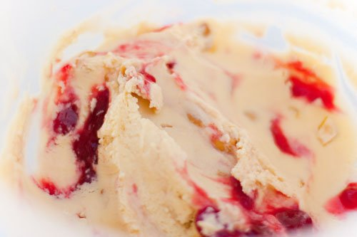 Baseball Nut Ice Cream: My husband's absolute favorite ice cream, Baseball Nut Ice Cream! A Rich creamy homemade vanilla ice cream swirled with a raspberry ribbon and crunchy cashews. You know, this ice cream is now one of my favorites too! #icecream #homemade #baseballnut https://lifecurrentsblog.com/