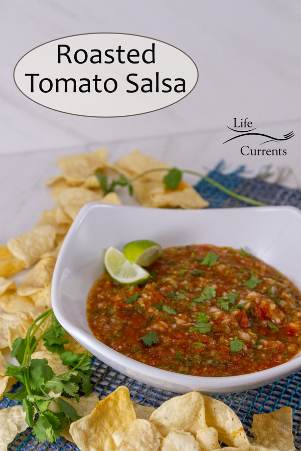 salsa in a large white bowl surrounded by chips, title on image: Roasted Tomato Salsa.