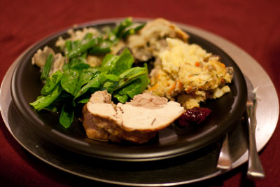 That's a happy looking plate of rolled turkey, spinach salad, green bean bake, mushroom torte, stuffing, and cranberry sauce thanksgiving