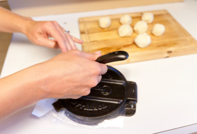 Homemade tortillas encase fillings like Seasoned Black Bean Mash, Verde Queso Fun-dito, and Homemade Guacamole. step6 tortillas