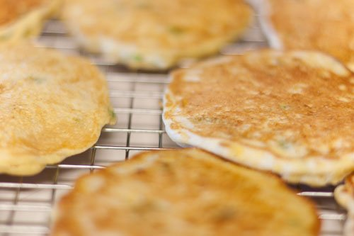 Island Trollers Summer Salad with Fresh Corn Cakes - Fresh corn cakes all cooling on a rack