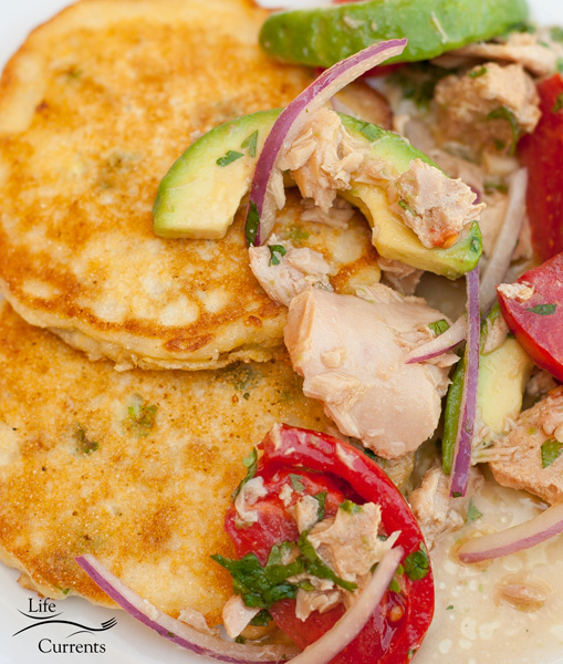 Island Trollers Summer Salad with Fresh Corn Cakes - with Garlic Albacore, avocado, tomatoes, and red onion all served on top of Fresh Corn Cakes