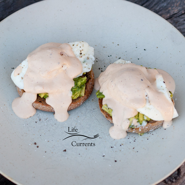 two Eggs Bennedict with Chipotle – Sour Cream sauce
